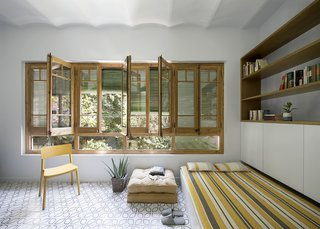 Previously an indoor/outdoor sunroom, the new gallery space includes a bespoke sofa that converts into a bed for overnight guests.