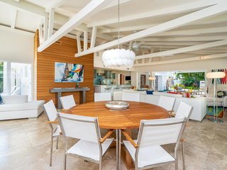A wall clad in cypress wood accentuates the dining area, which has room for a large table.