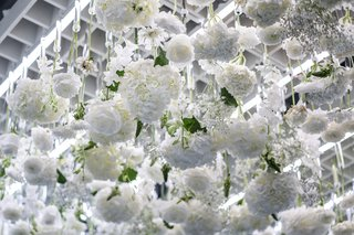 Over the course of the exhibition, 3,500 real and preserved flowers will be hung from a white trellis. They'll be replaced about once a week.