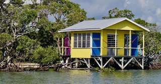 The homes were built in 2014 and are stilted to stay dry with changing tides and weather conditions. The festive colors are distinctly Caribbean.
