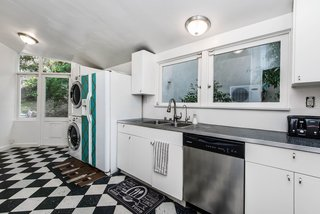 The roomy kitchen overlooks the backyard, with plenty of windows to brighten the space. A separate entrance provides access to the rear patio.