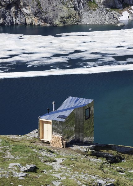 "Accessible only by foot, the On Mountain Hut is sited on Piz Lunghin, or ""the roof of Europe,"" the continent's only triple watershed. Water here flows into the Danube, Rhine, and Po rivers."