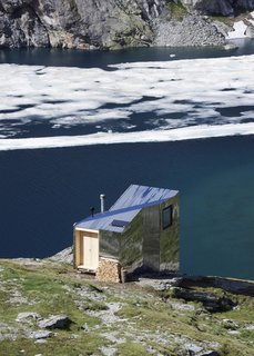 """Accessible only by foot, the On Mountain Hut is sited on Piz Lunghin, or """"the roof of Europe,"""" the continent's only triple watershed. Water here flows into the Danube, Rhine, and Po rivers."""