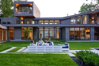 From the rear, the home's layout as a two-story structure becomes clearer, as does its aggressive use of angular dimensions and expansive walls of glass.