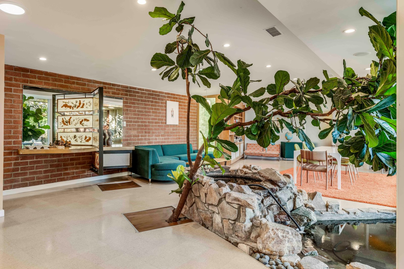 This 1954 House by Powers, Daly, and DeRosa Features a Koi Pond That Flows Under a Glass Wall