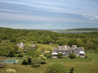 First built in 1981, the main house sits in the middle of the farm, overlooking views of the Atlantic Ocean and Squibnocket Pond. Clad in cedar-shake siding, the home follows the traditional Cape Cod style.