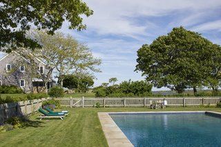 A large pool is surrounded by a grassy area for relaxing and entertaining. The Kennedys have long enjoyed this home as a summer retreat for their large family and close friends.