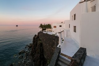 """The home's expansive terraces look out over panoramic views of the&nbsp;<span style=""""font-family: Theinhardt, -apple-system, BlinkMacSystemFont, &quot;Segoe UI&quot;, Roboto, Oxygen-Sans, Ubuntu, Cantarell, &quot;Helvetica Neue&quot;, sans-serif;"""">Tyrrhenian Sea.</span><span style=""""font-family: Theinhardt, -apple-system, BlinkMacSystemFont, &quot;Segoe UI&quot;, Roboto, Oxygen-Sans, Ubuntu, Cantarell, &quot;Helvetica Neue&quot;, sans-serif;"""">&nbsp;Stairs lead down along the stone retaining wall to the rocky shore below.&nbsp;<br></span>"""
