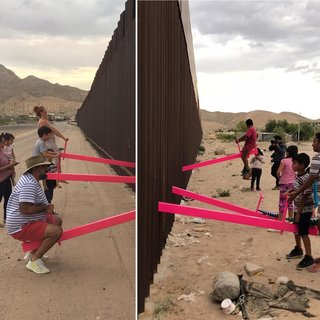 The seesaws slide through the fence's metal slats, turning the border wall into a literal and figurative fulcrum for the U.S. and Mexico.
