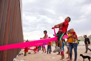 Pink Seesaws Let Kids Play Together Across the U.S.–Mexico Border Wall