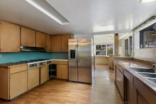 A large kitchen is located along the rear of first floor, off the dining room. Windows run above the sink and lead into a bright breakfast nook in the rear.