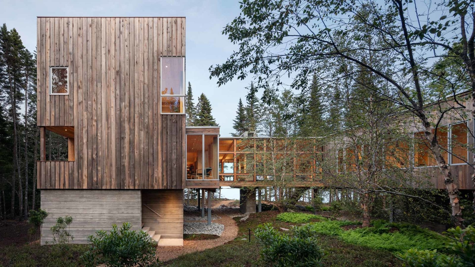 """""""The homeowner describing that he loved the mossy, fern understory brought the idea to my mind to be up in the trees,"""" says architect Russ Tyson."""