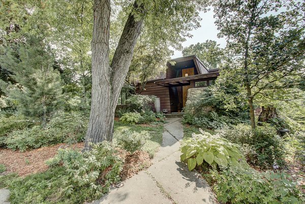 The home's shady corner lot is full of large Maple trees and lush plantings. A deep eave marks the grand entrance, which is further dramatized by 15-foot-tall double doors with Medieval-style hardware from Spain.