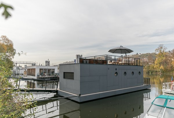 The exterior is wrapped in cement fiber boards with a Cembrit patina finish. Due to a lack of onshore infrastructure, a big challenge of the project was the addition of self-contained  sewage and clear water tanks.
