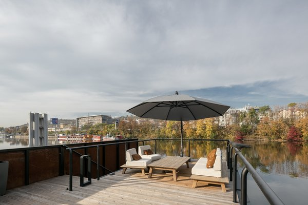 The roof deck looks out over quiet surroundings along a more secluded channel off of the Vltava River. Stairs to the terrace are only accessible from a smaller deck along the rear of the home.