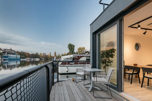 A private deck along the rear of the home offers space for enjoying sunsets over the water. Although only minutes from downtown Prague, the setting feels much further away.