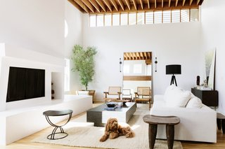 Few changes were made to the living room space, which is warmed by natural light that pours in from clerestory windows along the rafters.