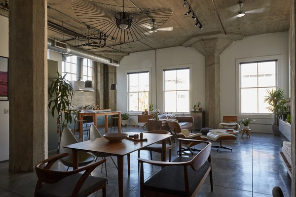 With high ceilings, Art Deco concrete pillars, and plenty of industrial details, this 1,462-square-foot corner loft is a striking private residence.