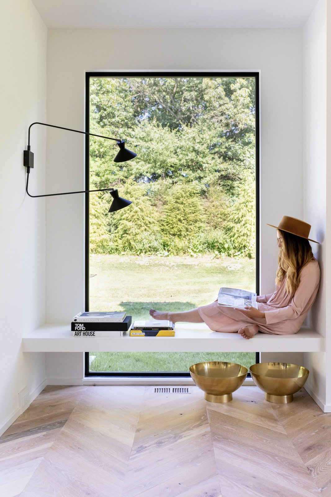 "Windows and Picture Window Type ""When it came to designing the inside of the home, we wanted to have your eye continue on through the glass instead of landing on a lot of details,"" comments Liz.  Photo 2 of 10 in Watch How This Danish-Style Farmhouse Unites a Family With Nature"