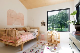 The large windows continue into each of the bedrooms, where they frame picturesque views of the landscape.
