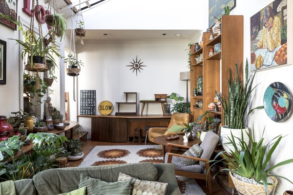 John's passions for midcentury furniture and gardening dominate the space, a project which started seven years before Ricky moved in. Ricky relinquished his preference for sleek modernism in return for the sprinkling of Madonna-themed decor.