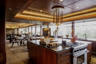 A chef's kitchen now occupies the space that once held the smoking lounge and Ray's office. The mahogany cabinetry was inspired by the former restaurant kitchen at Lynn Hall.