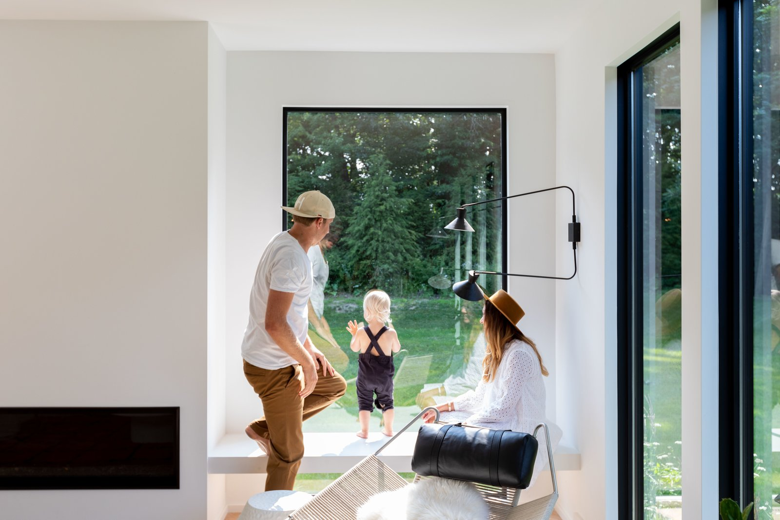 """Windows and Picture Window Type """"When it came to designing the inside of the home, we wanted to have your eye continue on through the glass instead of landing on a lot of details,"""" comments Liz.  Photo 5 of 10 in Watch How This Danish-Style Farmhouse Unites a Family With Nature"""