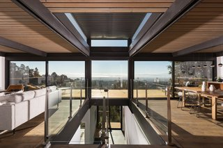 Upon entering the home, a central gathering of clerestory windows immediately focuses the view. Architects Bridgett Shank and Megan Carter refer to this architectural feature as a 'light monitor.'