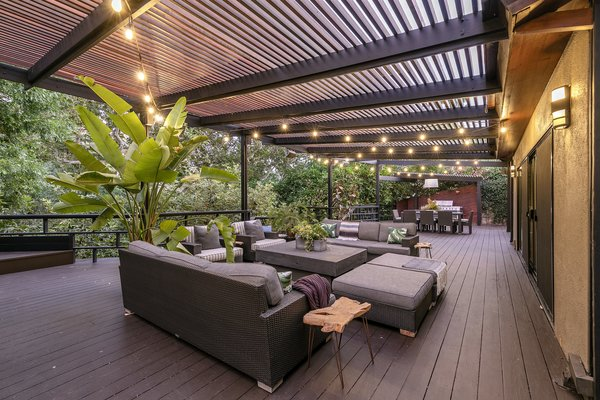 The star of the home is a 2,500-square-foot deck offering an outdoor grill and numerous seating areas—perfect for entertaining or enjoying the natural surroundings.