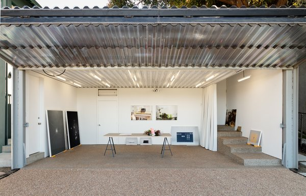 A Corrugated, Plastic Bifold Door Opens Up an Artist's Tiny L.A. Studio