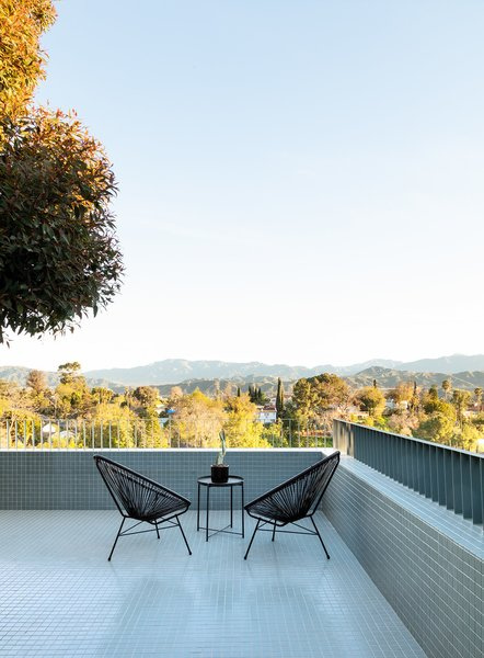 Acapulco chairs sit atop the deck, which looks north to the San Gabriel Mountains.
