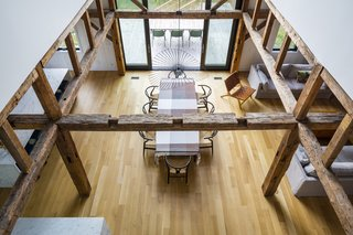 Looking down from the upstairs loft, the original post and beam structure defines the grand open space.