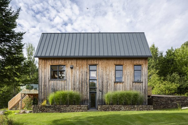 A couple renovated an old farmhouse in Quebec to serve as their vacation home—and didn't stop there. They looked to the old dilapidated barn on the property, and transformed it into a sprawling 4,500-square-foot guest house for their adult children.