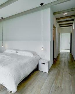 A view of the minimalist master bedroom.