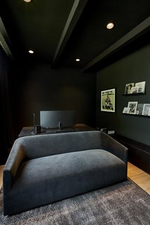 A look at the moody office space, which is outfitted in handsome darker tones.