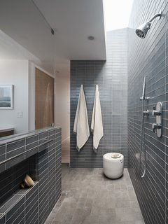 A view of the stylish master bathroom, which features a skylight above the shower.