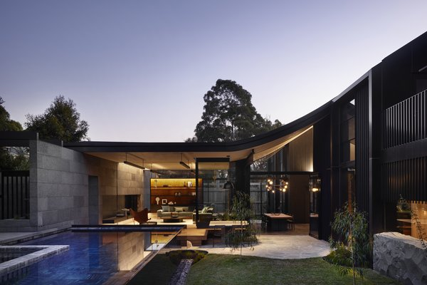 The sweeping roof and courtyard glows underneath the moonlight.