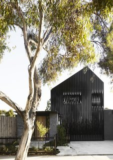 A look at the home's front facade. In a Melbourne suburb, Splinter Society Architecture designed the versatile home for Mark and Cara Harbottle and their three young children.
