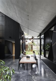 "Another view of the dining area with its sloping ceiling. ""We wanted to know that the house would last a long time, so no matter what age the kids were, it would be appropriate,"