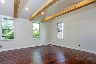 A look at the 600-square-foot studio. The open space offers beamed ceilings and is a blank canvas for the new homeowner.