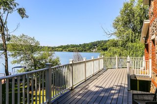The side of the home offers a large deck with panoramic views of Putnam Lake.