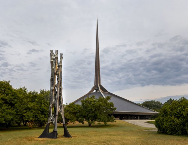 Filament Tower by University of Tennessee, Knoxville professor Marshall Prado is a 30-foot carbon fiber tower that references the spire of Eero Saarinen's North Christian Church behind it.