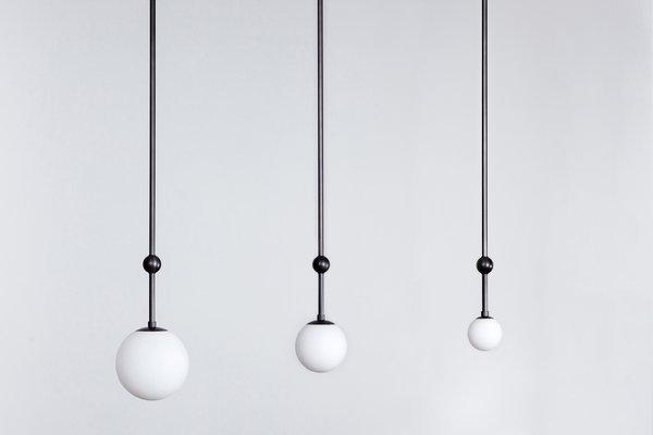 Collection of three Orbit pendants by Ryan Edward Studio