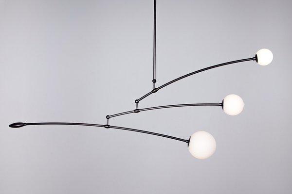 The Orbit chandelier by Ryan Edward Studio.
