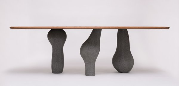 The Altar dining table from Agnes Studio, composed of lava rock and elephant ear wood.