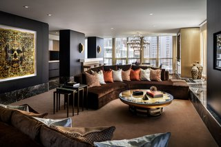 The Bisha Suite living room features a curved, velvet couch.