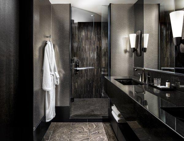 The dark-hued bathroom feels like a sanctuary.