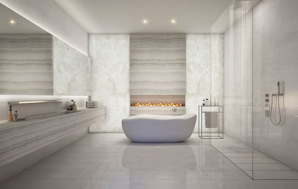 A look at one of the marble-clad bathrooms, this one offering a fireplace, large soaking tub, and walk-in shower.