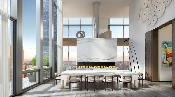 Located just steps away from the kitchen, a formal dining area frames expansive city views around a marble-clad fireplace. The space also offers direct access to one of the home's multiple terraces.