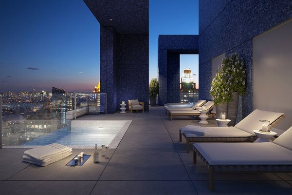 Along with terraces on each floor, the penthouse also includes a private wraparound roof deck that features a Jacuzzi and 67-foot salt-water lap pool that stretches out over Manhattan.